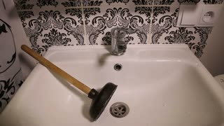 Sink and a Plunger