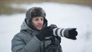 Smiling photographer outdoor in winter