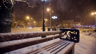 Snow falls in a christmass city