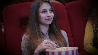 Teenage girl watching movie in cinema