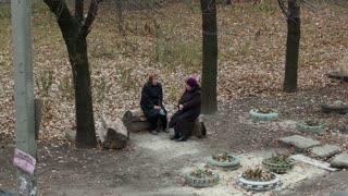 Two Elderly Women Sitting and Talking