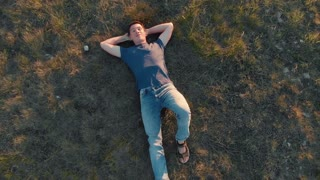 Aerial shot young man lying down and resting