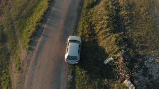 Aerial view of a broken car on country road