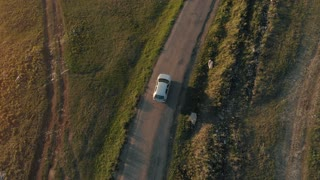Aerial view of a car driving on country road