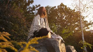 Ascetic meditates on the stone