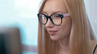 Blonde Woman Working on Computer