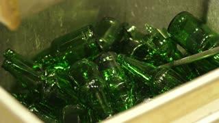 Broken bottle in a bin