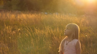 Cute little girl at sunset