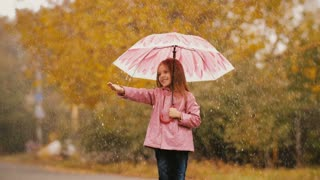 Cute Little Girl With Umbrella Under Rain