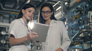 Engineers in mechanical factory working