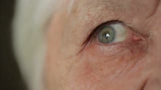 Eye of old woman at home