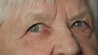 Eyes of old woman looking straight