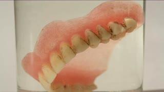 False teeth in glass of water