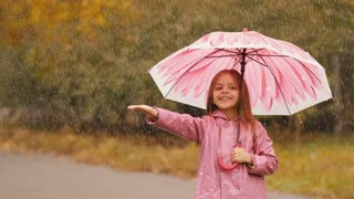 Girl With Umbrella Under Rain