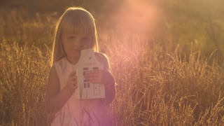 Little girl holding a model of a house
