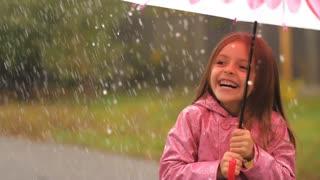 Little Girl Under Rain Having a Fun