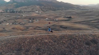 Man resting in mountians