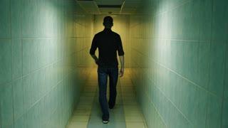 Man walk away down a corridor