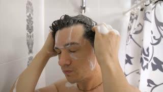 Man wash hair with shampoo