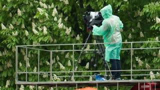 Man With Camera at rain