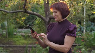 Middle aged woman using cell phone