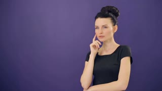 Pensive woman at lilac background