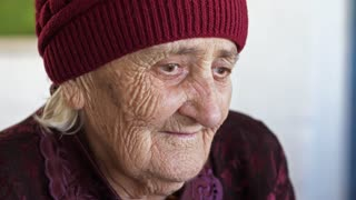 Sad Old Woman in Hat