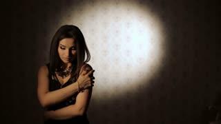 Sad Woman in a dark room