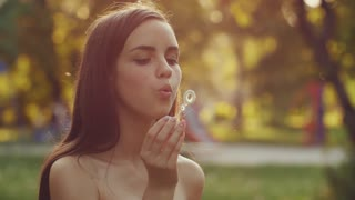 Teenage girl blowing bubbles