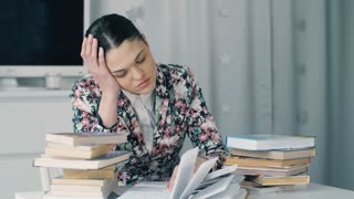 Tired woman with a lot of books