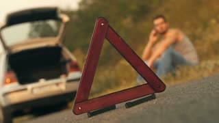 Triangle in a front of broken car