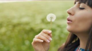 Woman Blow Dandelion