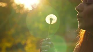 Woman Blow on a Dandelion