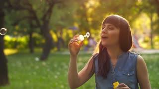 Woman blowing soap bubbles