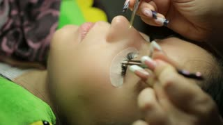Woman making a false eyelashes