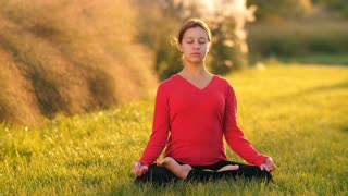 Woman meditates on nature