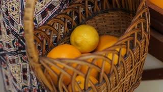 Woman Puts Fruits at Basket