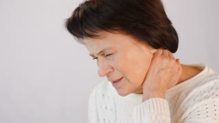 Woman with severe pain in the neck