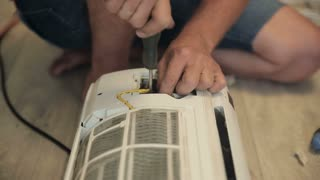 Worker Repair Air Conditioner
