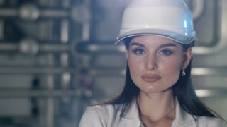 Young engineer woman at hard hat