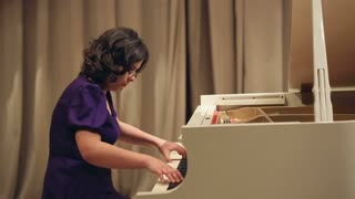 Woman Play a Piano