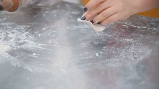woman rolls the dough