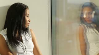 Woman With Complexes Reflected in Window