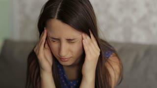 Woman's Terrible Headache