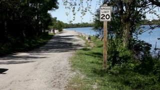 20 MPH Speed sign next to Lake
