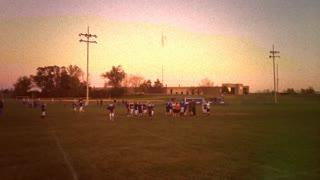 8mm Vintage video of kids practicing football