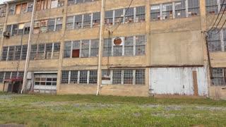 Abandoned warehouse building establishing tilt shot 4k