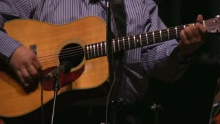 Acoustic Guitar in front of Microphone