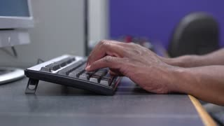 African american male hands typing