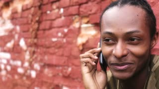 African American Male on cell phone pan